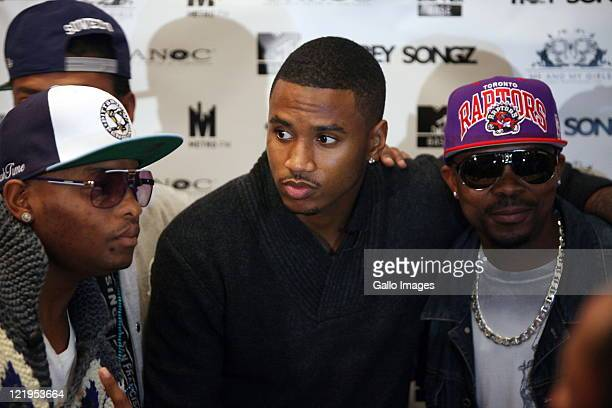 American singersongwriter Trey Songz poses with local band Teargas during a press conference ahead of his concerts this weekend on August 23 2011 in...