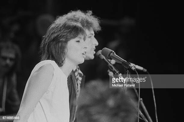 American singersongwriters Bob Dylan and special guest Chrissie Hynde of The Pretenders performing at Wembley Stadium London 7th July 1984