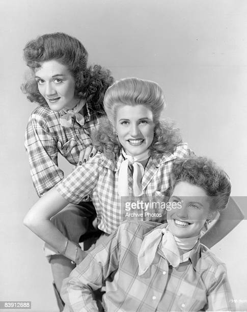American singing group The Andrews Sisters wearing plaid blouses and neckerchieves 1944 They are sisters LaVerne Sophie Andrews Maxene Angelyn...