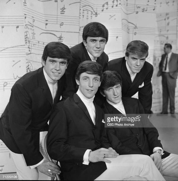 American singing group The Dave Clark Five pose on stage at 'The Dave Clark Five' New York New York March 3 1964 Clockwise from top Dave Clark Lenny...