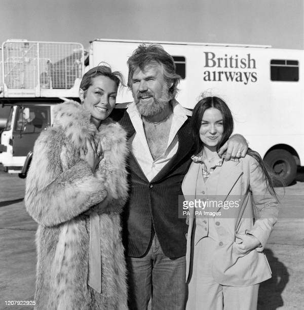 American singing star Kenny Rogers at London's Heathrow airport when he arrived with his two favourite ladies his bride of a few weeks television...