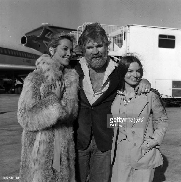 American singing star Kenny Rogers at London's Heathrow airport when he arrived with his two favourite ladies - his bride of a few weeks, television...