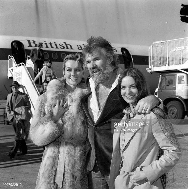 American singing star Kenny Rogers has died He is pictured at Heathrow arriving with his two favourite ladies his bride of a few weeks television...