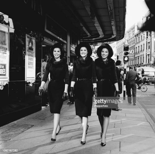 American singing trio The McGuire Sisters featuring Christine Dorothy and Phyllis McGuire pictured together outside the The Talk of the Town...
