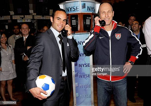American soccer player Landon Donovan and United States men's national soccer team head coach Bob Bradley ring the closing bell at the New York Stock...