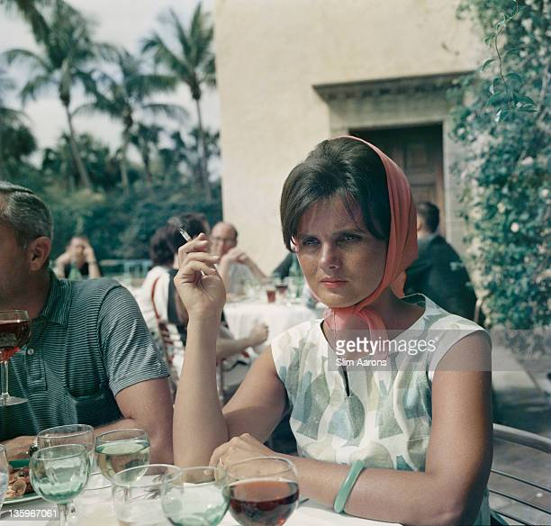 American socialite and fashion designer Lilly Pulitzer at a pool party Palm Beach Florida April 1961
