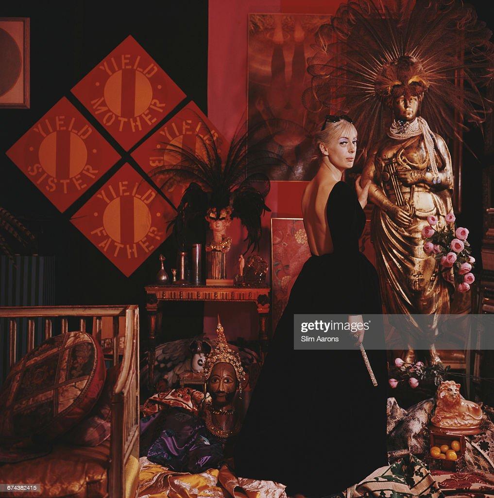 American socialite and fashion designer Tiger Morse (1932 - 1972) sits in the 'A la Carte' shop, New York, 1964.