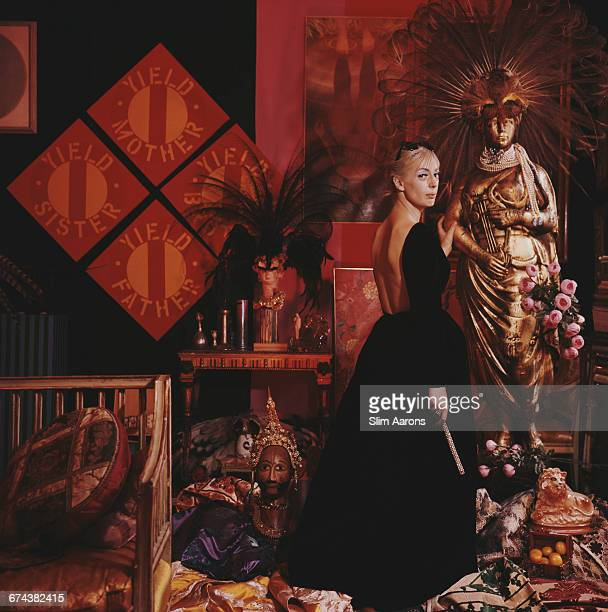 American socialite and fashion designer Tiger Morse sits in the 'A la Carte' shop New York 1964