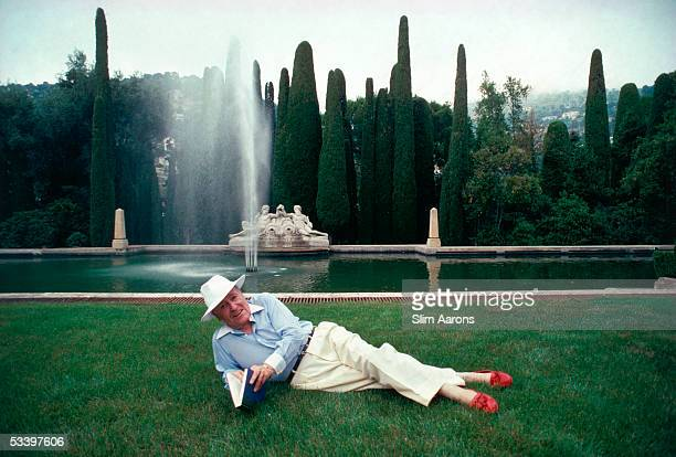 American socialite and friend of Nancy Reagan Jerry Zipkin reclines on the lawn at the estate of Edmond and Lily Safra in La Leopolda France 1991