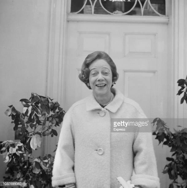 American socialite and philanthropist Brooke Astor widow of Vincent Astor pictured in front of the door of a house on 19th April 1963
