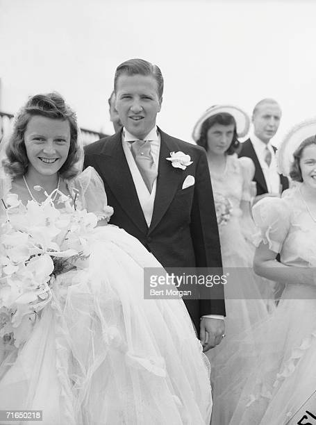 American socialite Anne McDonnell Ford and her new husband automobile executive Henry Ford II pose for a portrait at their wedding Southampton New...