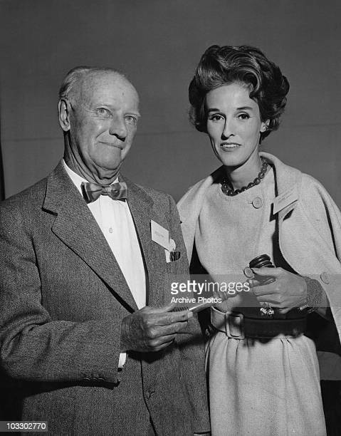 American socialite Babe Paley presents Joseph E Ridder with the President's Gavel at the Annual Meeting of the Trustees of North Shore Hospital...