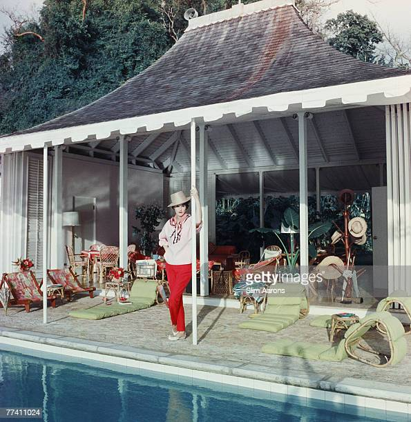 American socialite Babe Paley the wife of CBS radio executive William S Paley beside the pool at Round Hill their villa in Jamaica 1959