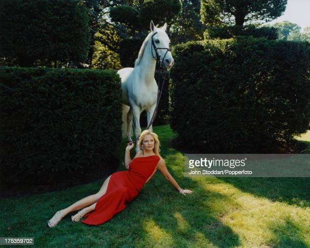 American socialite Cornelia Guest posing with a white horse circa 2000