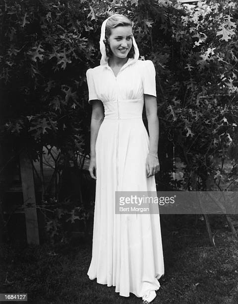 American socialite Edith Beale models a dress outdoors during a fashion show at the East Hampton Fair East Hampton Long Island New York c 1938