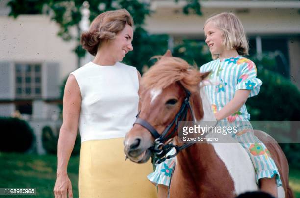 American socialite Ethel Kennedy smiles at her daughter Kathleen Kennedy outside their home Hickory Hill McLean Virginia 1967