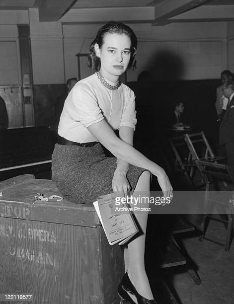 American socialite, fashion designer, actress, writer and artist Gloria Vanderbilt, January 1955. She is holding a copy of the Pulitzer Prize-winning...