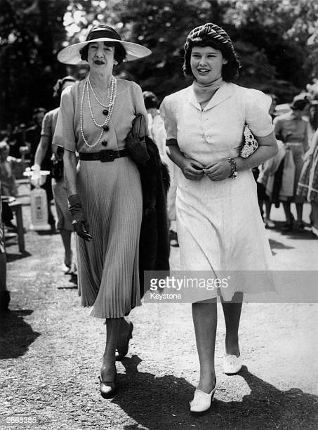 American socialite, heiress and fashion designer Gloria Vanderbilt with her aunt Gertrude Payne Whitney at a party on Long Island.