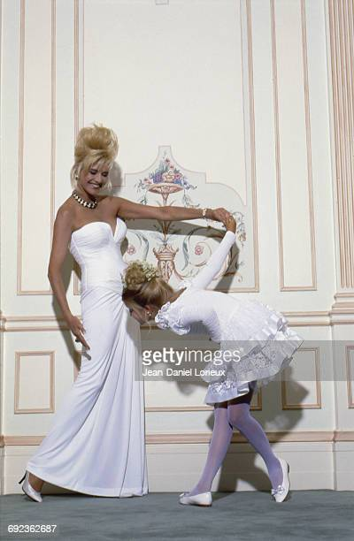American socialite Ivana Trump wife of mogul Donald Trump at the Century Plaza Hotel they own posing with her daughter Ivanka Trump August 1990