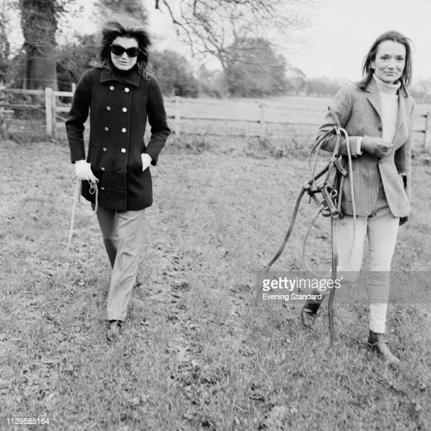 American socialite Jacqueline Kennedy Onassis with her sister American socialite Lee Radziwill at a horse farm UK 15th November 1968