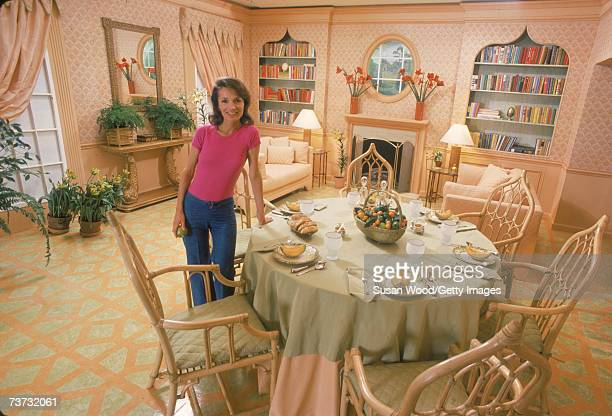 American socialite Lee Radziwill stands and displays her dining room, March 1976.