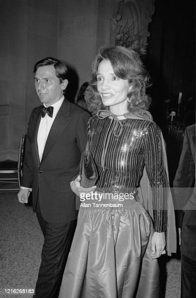 American socialite Lee Radziwill , with a guest, arrives at the Glory of Russian Costume Exhibition, held in the Metropolitan Museum of Art Costume...