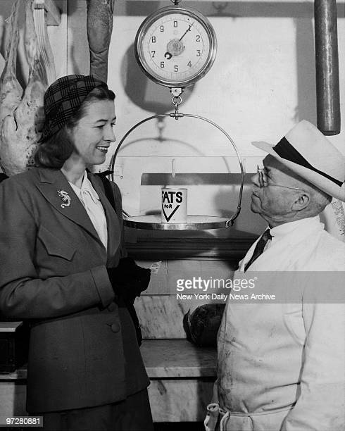 American socialite Mary Benedict Cushing wife of Vincent Astor shows how you turn in a pound of salvaged fats and receive two ration stamps