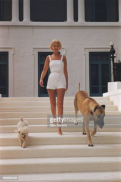 American socialite Mrs Winston F C Guest with a poodle and a Great Dane at her oceanfront estate Villa Artemis in Palm Beach Florida circa 1955