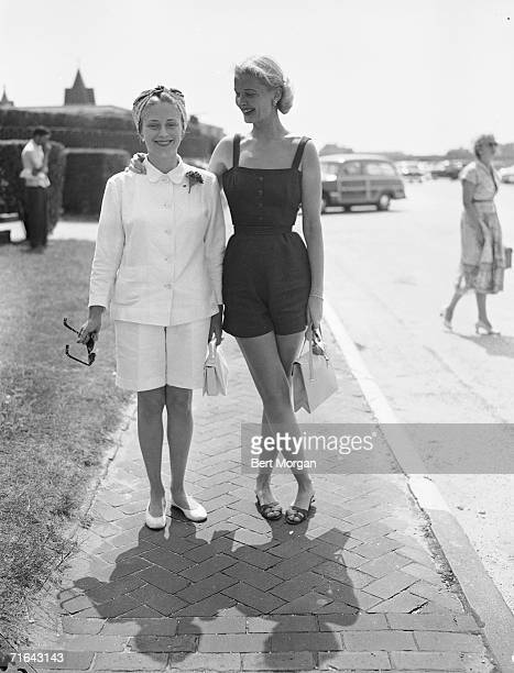 American socialites Rosemary Warburton Gaynor , wife of Dr. William C.T. Gaynor, and C.Z. Guest , wife of Winston F.C. Guest, pose for a picture...