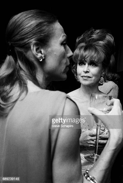 American society columnist Aileen Mehle listening to a guest at a party 1966 Mehle's column written under the name of Suzy Knickerbocker was...