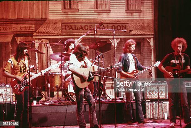 American soft-rock ensemble The Eagles perform on stage before a faux Old West backdrop, 1974. Members of the band are bassist Randy Meisner, drummer...
