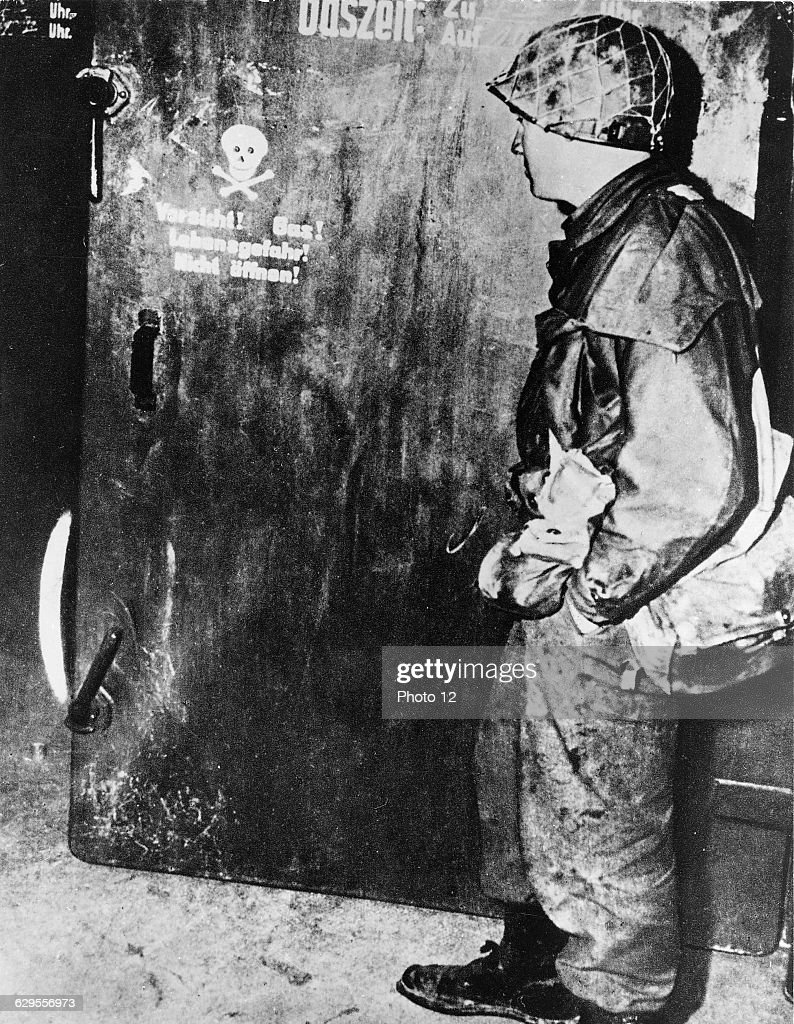 American soldier before a gas chamber door at a Nazi Concentration C&.1945. & American soldier before a gas chamber door at a Nazi Concentration ...