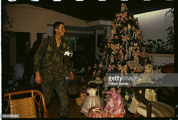 American soldier contemplates a Christmas tree in the former home of Panamanian dictator Manuel Noriega