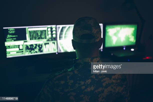 american soldier in headquarter control center - military stock pictures, royalty-free photos & images