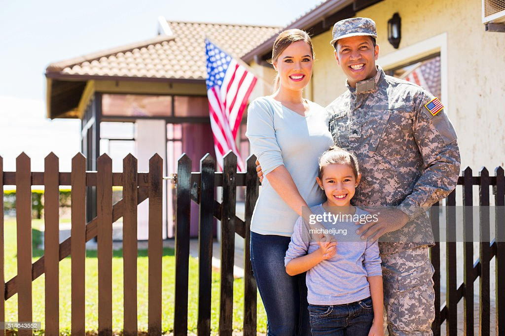 american soldier reunited with family : Stock Photo