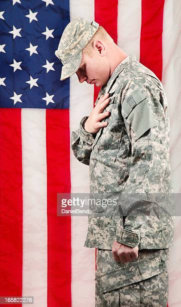 american soldier series: young sergeant standing against usa flag - soldier praying stock photos and pictures