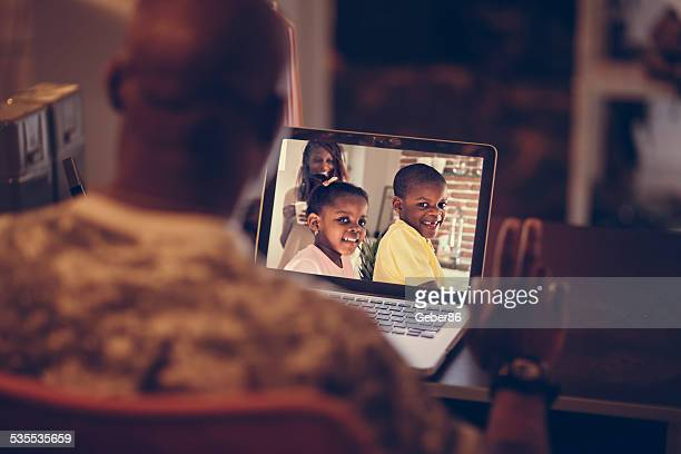 american soldier talking to his family - marines military stock photos and pictures