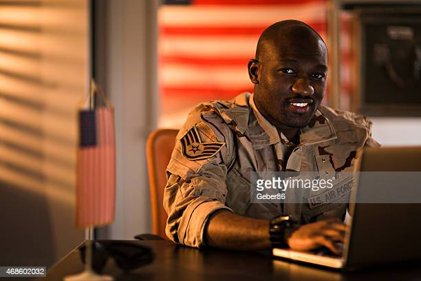 american soldier using laptop - air force stock pictures, royalty-free photos & images