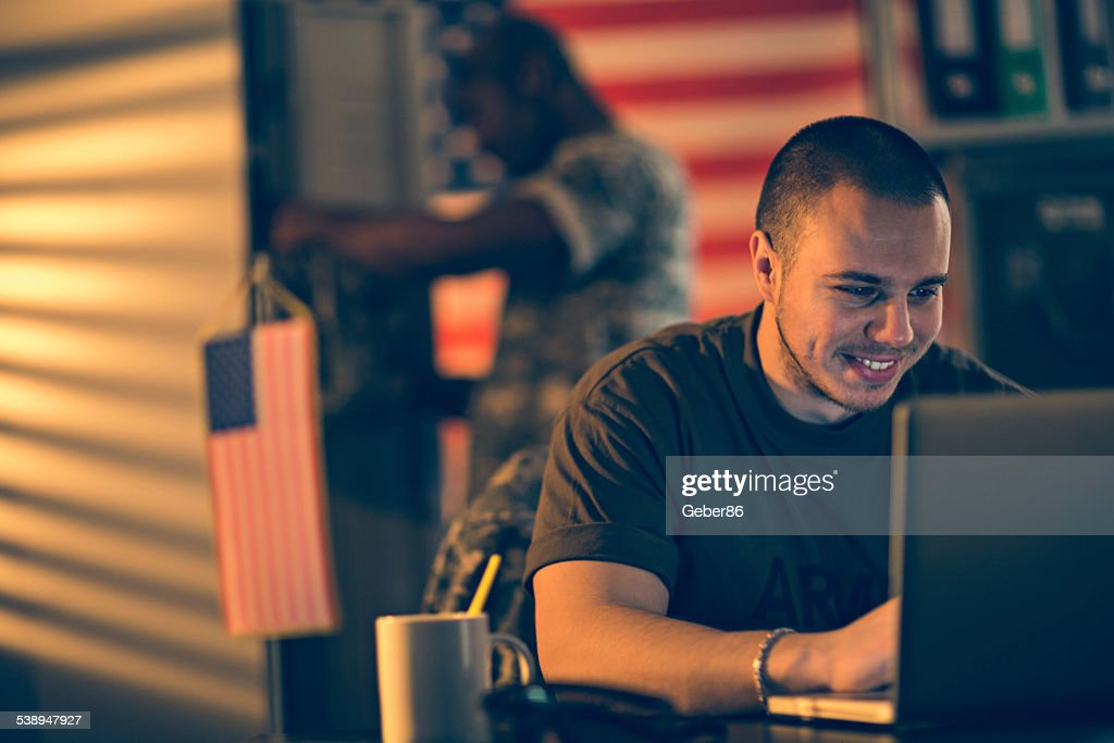 American soldier using laptop : Stock Photo