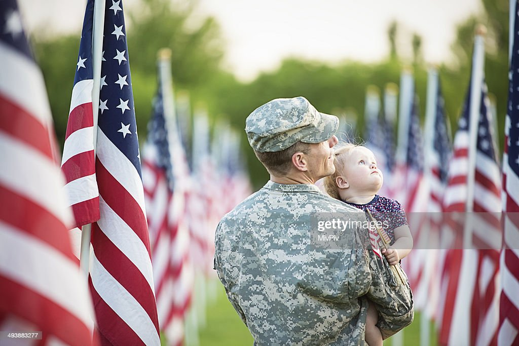 American soldier with daughter : Stock Photo