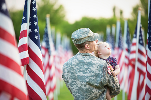 American soldier with daughter 493883277