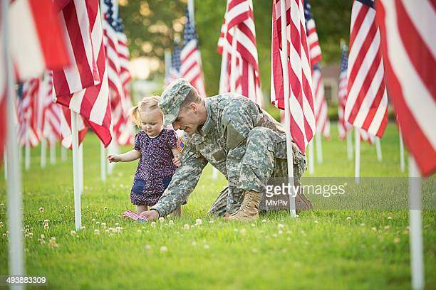 American soldier with daughter