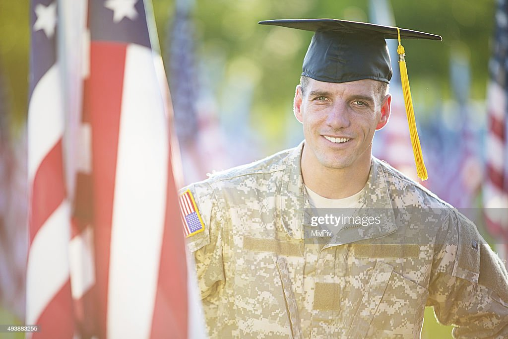 American Soldier with graduation hat : Stock Photo