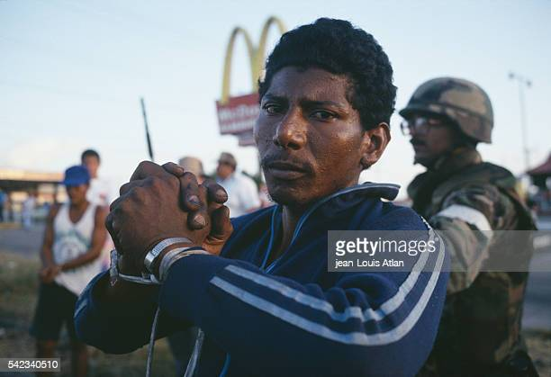 American soldiers arrest rebels following their deployment in Panama to overthrow Manuel Antonio Noriega.