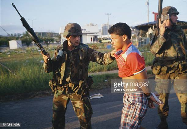 American soldiers arrest rebels following their deployment in Panama to overthrow Manuel Antonio Noriega