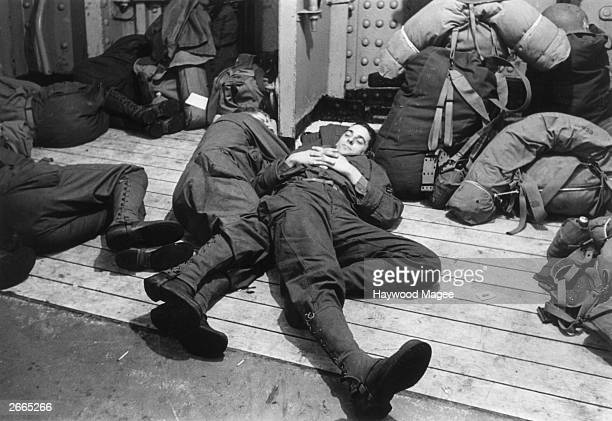 American soldiers asleep on the Cunard White Star liner Queen Mary which is serving as a troopship during World War II Original Publication Picture...