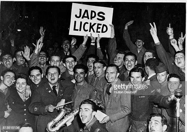 American Soldiers at the Rainbow Corner Red Cross Club in Paris celebrate the surrender of Japan and the end of World War II