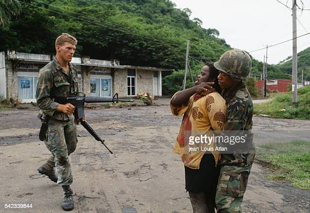 American soldiers capture a local man during the US invasion of the island of Grenada | Location Grenada
