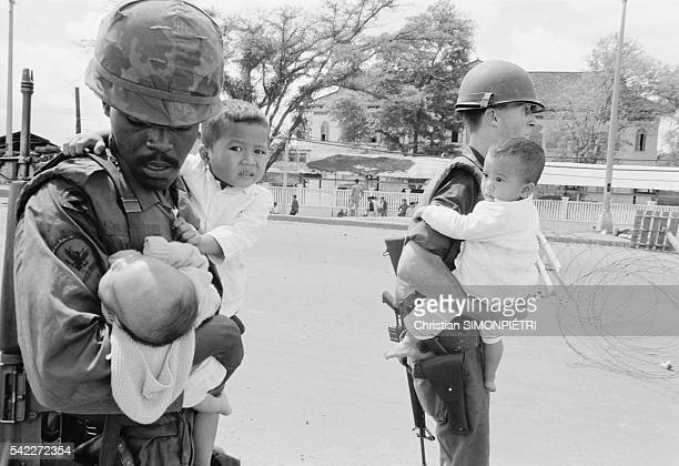 American Soldiers Carrying Children During Second Offensive on Saigon