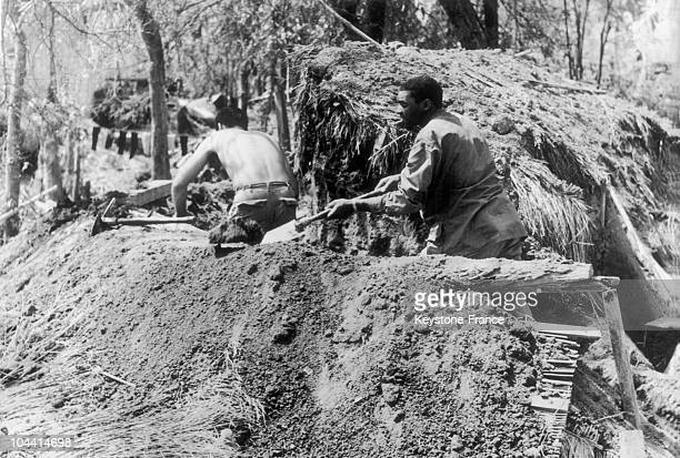 00/00/19651970 American soldiers constructing a defensive position against Viet Cong attacks 25 miles south of Quang Ngai city where fighting is...